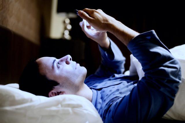 man-phone-bed-sleep