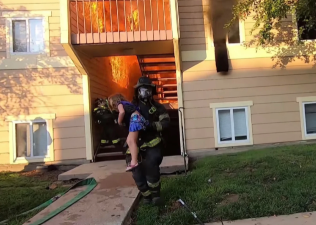 The firefighter saves the little girl