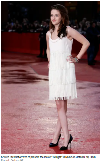 Kristen in a white dress