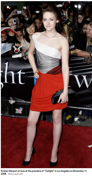 In a one-shoulder dress