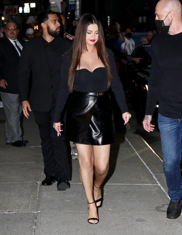 Selena Gomez in a black skirt