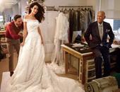 دى لا رينتا بجوار آخر أعماله فستان زفاف آمال علم الدين