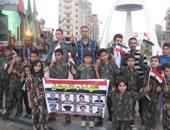 مجموعة من الأطفال والشباب بميدان الثورة بالمنصورة لتأيد الجيش والشرطة