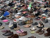 استخدام الأحذية احتجاجا على منع السلطات للمظاهرات قبل قمة المناخ