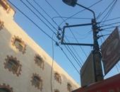 أسلاك كهرباء سقطت بشارع فى بسيون
