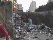 صورة توضح القمامة المتراكمة في شوارع السيدة زينب