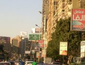 أعمدة مضاءة نهارا فى شارع جامعة الدول العربية