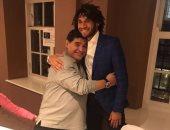 محمد الننى مع مارادونا