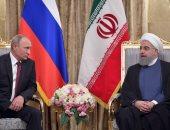 الرئيس الإيرانى حسن روحانى ونظيره الروسى فلاديمير بوتين