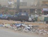 تراكم القمامة بالشارع