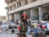 مسلحون سوريون ينهبون محال تجارية فى عفرين