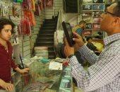 تاجر سورى فى سوق الموسكى ومحرر اليوم السابع
