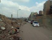 القمامة تغلق شارع جسر السويس