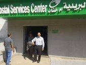 النائب إبراهيم حمودة أمام مكتب بريد أمام خنان خلال تطويره