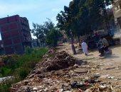 القمامة تحاصر مصرف كنيسة دمشيت بالغربية