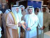 عبد الله ماجد آل على ومحمد الجابرى (وزير الإعلام)