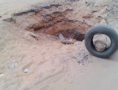 حفرة عميقة فى منتصف شارع الجمهورية بسوهاج