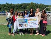 """سيدات مصريات بنيويورك يرفعن لافتة """"تبرعوا لأطفالنا"""" لدعم معهد الأورام"""