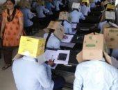 صور للطلاب أثناء التجربة