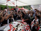 أبناء علاء أبو فخر يحملون العلم اللبنانى