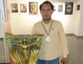 الفنان أشرف الكورى