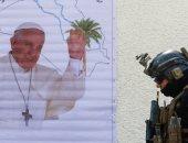 ملصق يحمل صورة البابا فرانسيس فى بغداد