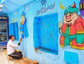 الشاب لؤى محمد يرسم على الجدران