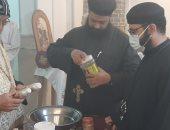الأنبا يواقيم يطيب رفات الشهيد أبو سيفين بكنيسة العذراء مريم بإسنا