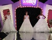 جانب من عرض فساتين الزفاف