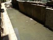 مياه الصرف الصحى تغرق شارع 14 بالدقى