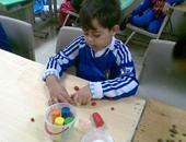 جانب من ورشة تعليم الأطفال الصلصال