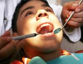 شخص يجز على أسنانه - أرشيفية