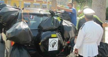 تداول صورة لتعليق أكياس قمامة بسيارة  هانى المسيرى .. ومصدر بالمحافظة ينفى