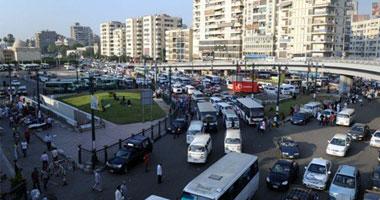 مشادات بين الأهالى والسائقين لرفع الأجرة لـ3 جنيهات بميدان الجيزة