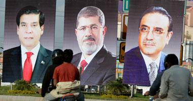 صورة مرسى وزرادى بشوارع باكستان ترحيبا بزيارة الرئيس المصرى