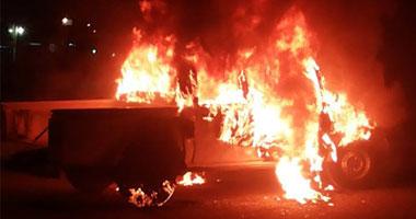 مجهولون يشعلون النيران فى سيارة شرطة بشارع فيصل