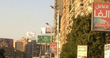 قارئ يرصد إضاءة أعمدة الكهرباء نهارا فى شارع جامعة الدول بالمهندسين