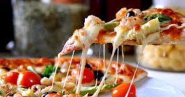 طريقة عمل البيتزا..بالصور والخطوات
