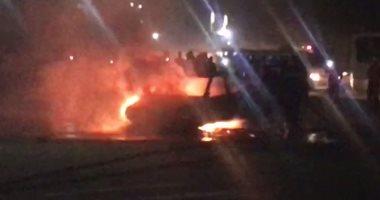 تفحم سيارة بالكامل أعلى دائرى المنيب ورجال الحماية المدنية يسيطرون على النيران