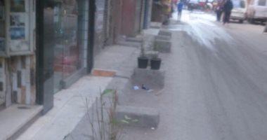 أصحاب محلات شارع أحمد ماهر بفيصل يواصلون التعدى على الطريق