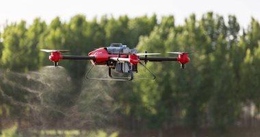 شركة صينية تطور طائرة بدون طيار جديدة لمساعدة المزارعين فى الحقل