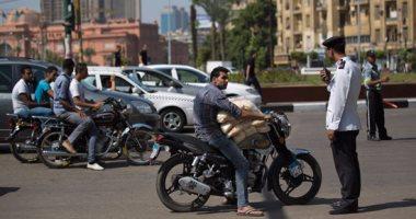 حملات مرورية بمحاور القاهرة والجيزة لرصد مخالفى المرور