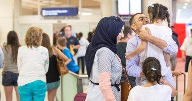 بالصور.. مهاجرون يصلون مطارات أمريكا تزامنا مع تنفيذ قرار الحظر الرئاسى