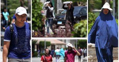 الكاب والشمسية.. حلول المصريين لمواجهة ارتفاع درجات الحرارة