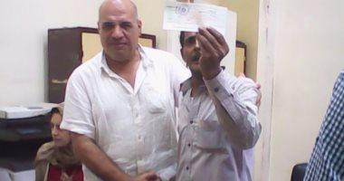 بالصور.. تسليم التعويضات لـ17 أسرة بالدفعة الثانية من سكان مثلث ماسبيرو