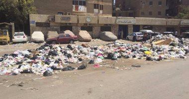 بالصور.. مقلب قمامة يعكر صفو حياة سكان شارع طريق النصر بإمبابة