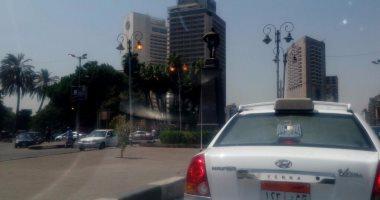 """بالصور.. فى عز الظهر.. أعمدة الإضاءة تهدر الكهرباء بـ""""يد الحكومة"""""""