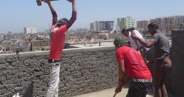 بالصور : إزالة الأدوار المخالفة فى منطقة حى غرب بسوهاج