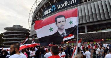 جماهير سوريا ترفع صور بشار الأسد فى مباراة أستراليا