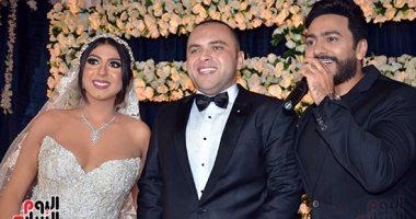 بالصور..  تامر حسنى يتألق فى زفاف حازم جمال ودينا أبو النصر